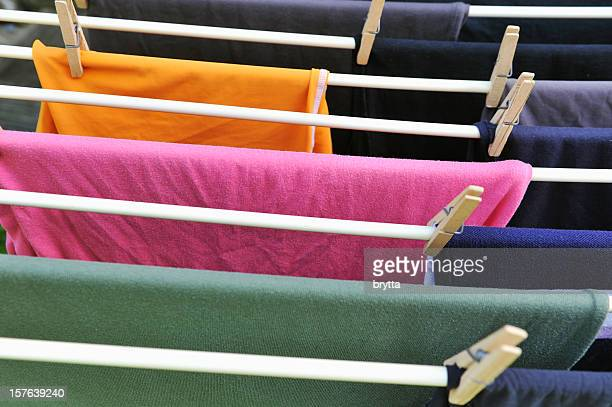 Drying rack with colored T-shirts and wooden clothespin