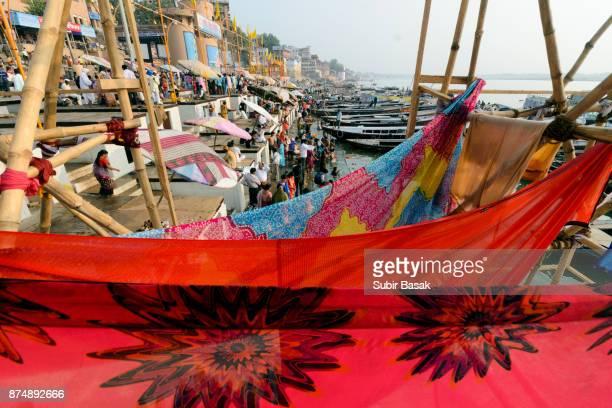 Drying saris on ghats at Ganges river in Varanasi, Uttar Pradesh.