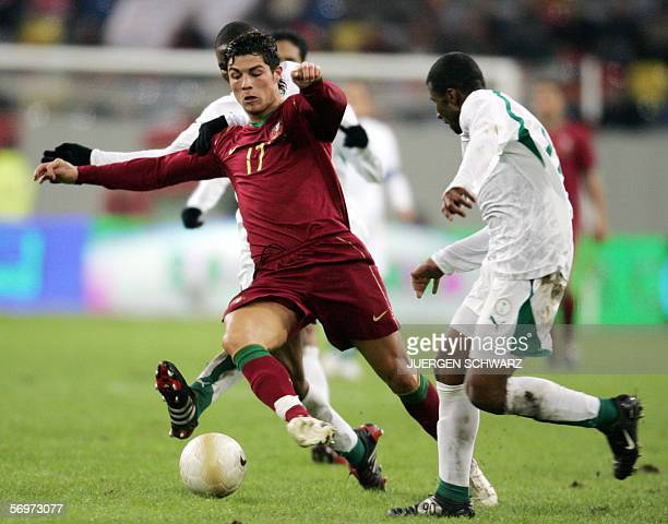 SaudiArabia's Khaled Aziz Al Thaker vies against Portugal's Cristiano Ronaldo 01 March 2006 at the LTUArena stadium in Dusseldorf during their...