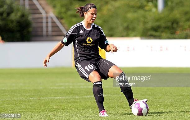 Dszenifer Marozsan of Frankfurt runs with the ball during the Women's bundesliga match between FCR Duisburg and FFC Frankfurt at the PCCStadium on...