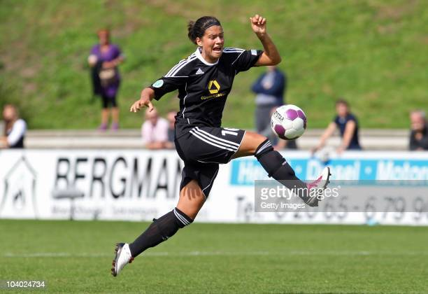 Dszenifer Marozsan of Frankfurt stopps the ball during the Women's bundesliga match between FCR Duisburg and FFC Frankfurt at the PCCStadium on...