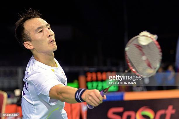 Du Pengyu of China returns a shot against Sai Praneeth of India during the OUE Singapore Open tournament men single quarterfinal in Singapore on...