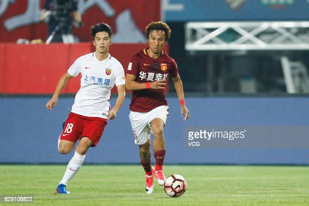 Du Wei of Hebei China Fortune and Zhang Yi of Shanghai SIPG vie for the ball during the 21st round match of 2017 China Super League between Hebei...