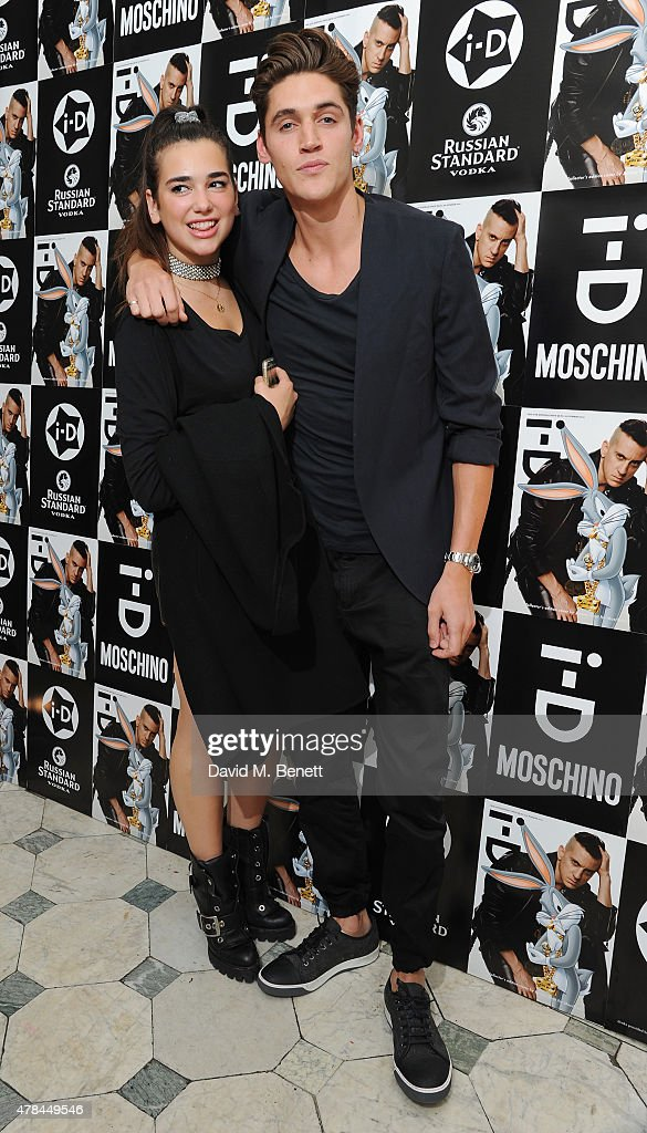 Dua Lipa and Isaac Carew attend the i-D 35 x Jeremy Scott for Moschino party celebrating i-D Magazine's 35th anniversary at Il Bottaccio on June 24, 2015 in London, England.