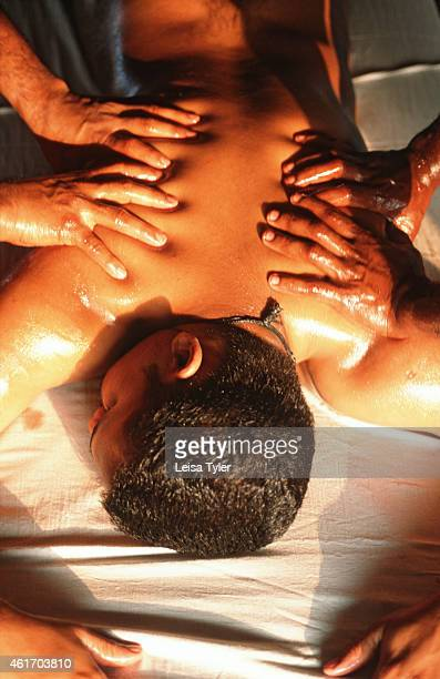 Dual massage an ayurvedic application where two therapists simultaneously massage a patient stimulating the nervous system and encouraging...