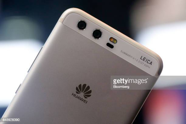 Dual rear facing cameras by Leica sit on the back of P10 smartphone manufactured by Huawei Technologies Co Ltd on the opening day of the Mobile World...
