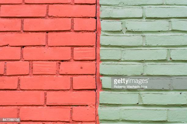 Dual toned brick wall half of it is brick red and half is light green Colour contrasts in old buildings