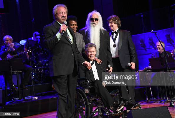 Duane Allen William Lee Golden and Richard Sterban of The Oak Ridge Boys and Charley Pride perform onstage with inductee Randy Travis during the 2016...