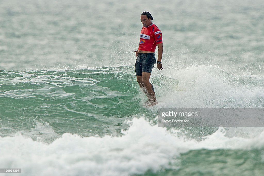 Duane Desoto of Hawaii/Ohau hangs ten on his way to easel;y winning round one heat at the 2012 CITIC PACIFIC ShenZhou Peninsula Pro in China on November 27, 2012 in Hainan Island, China. Desoto defeated Adam Griffiths of Great Britian to advance. Desoto is a former ASP Longboard World Champion (2010) and one of the favourites to win here. This is the only ASP World Title event for 2012 and will decide the world champion on November 27, 2012 in Hainan Island, China.