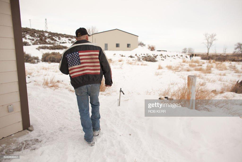 Duane Ehmer of Irrigon Oregon member of an armed antigovernment militia walks near a building at the Malheur National Wildlife Refuge Headquarters...