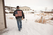 Duane Ehmer of Irrigon Oregon member of an armed antigovernment militia walks near a building at the Malheur National Wildlife Refuge Headquarters...