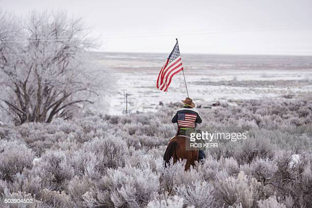 TOPSHOT Duane Ehmer rides his horse Hellboy at the occupied Malheur National Wildlife Refuge on the sixth day of the occupation of the federal...