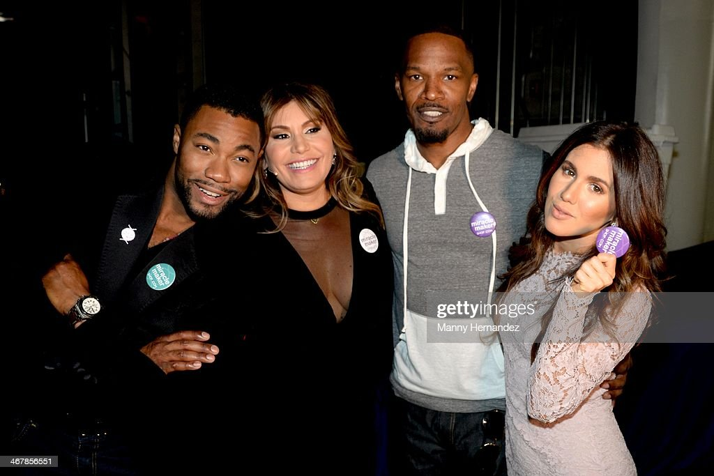 Duane McLaughlin, Loren Ridinger, Jamie Foxx and Amber Ridinger McLaughlin at the 2014 Market America World Conference at American Airlines Arena on February 8, 2014 in Miami, Florida.