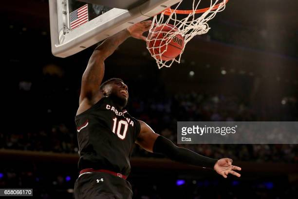 Duane Notice of the South Carolina Gamecocks dunks the ball against the Florida Gators late in the second half during the 2017 NCAA Men's Basketball...