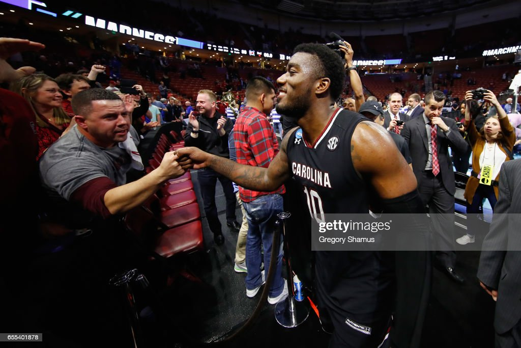 Duane Notice #10 of the South Carolina Gamecocks greets fans after defeating the Duke Blue Devils 88-81 in the second round of the 2017 NCAA Men's Basketball Tournament at Bon Secours Wellness Arena on March 19, 2017 in Greenville, South Carolina.
