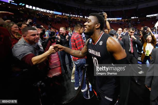 Duane Notice of the South Carolina Gamecocks greets fans after defeating the Duke Blue Devils 8881 in the second round of the 2017 NCAA Men's...