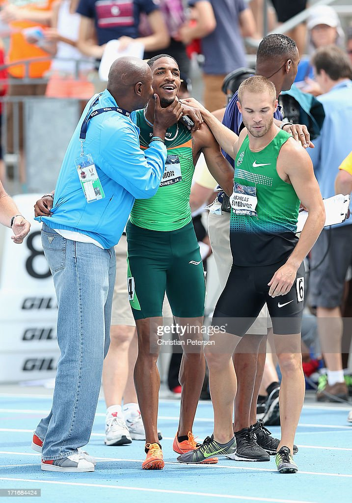 Duane Solomon Jr (C) is congratulated by his coach Johnny Gray after winning the Men's 800 Meter Run final on day four of the 2013 USA Outdoor Track & Field Championships at Drake Stadium on June 23, 2013 in Des Moines, Iowa.