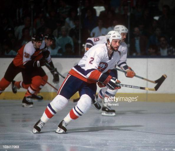 Duane Sutter of the New York Islanders skates up the ice during an NHL game against the Philadelphia Flyers in 1984 at the Nassau Coliseum in...