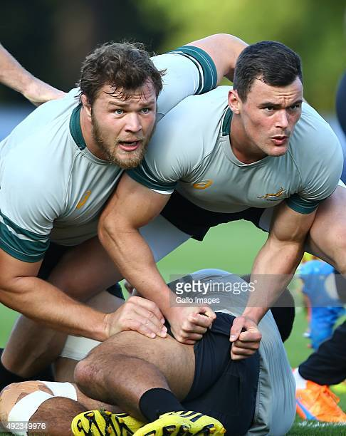 Duane Vermeulen and Jesse Kriel block during the South African national rugby team training session at Pennyhill Park on October 12 2015 in London...