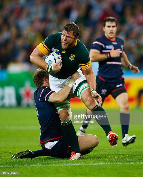 Duane Vermeulen of South Africa is tackled by Blaine Scully of the United States during the 2015 Rugby World Cup Pool B match between South Africa...