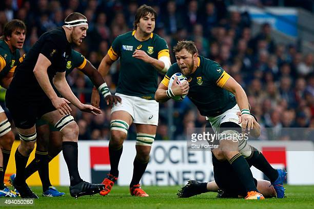 Duane Vermeulen of South Africa is tackled during the 2015 Rugby World Cup Semi Final match between South Africa and New Zealand at Twickenham...