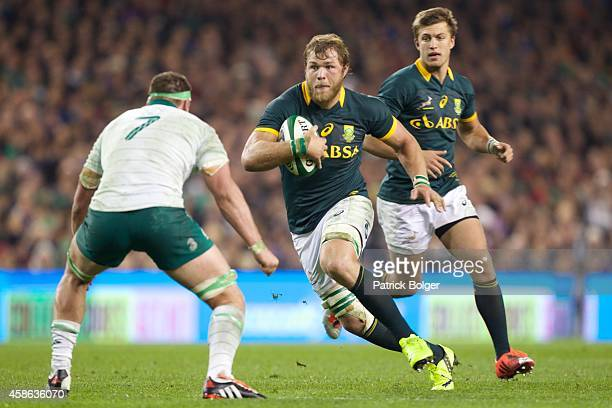 Duane Vermeulen of South Africa runs at Rhys Ruddock of Ireland during the 2014 Guinness series International match between Ireland and South Africa...