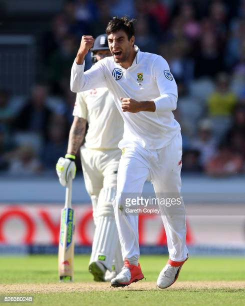Duanne Olivier of South Africa celebrates dismissing England captain Joe Root during day one of the 4th Investec Test between England and South...