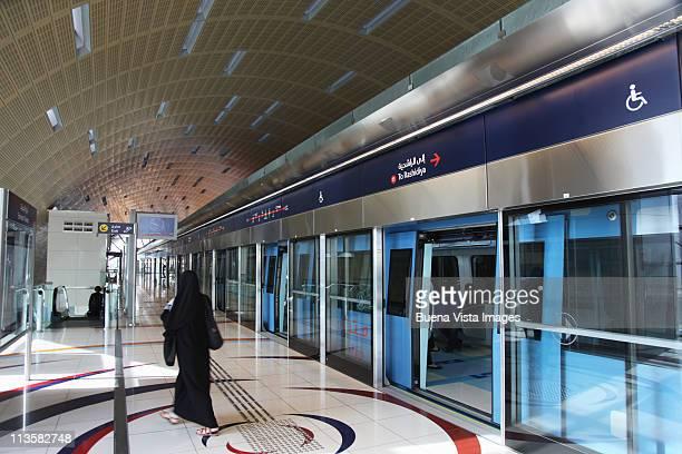 Dubai, arab woman in a metro station.
