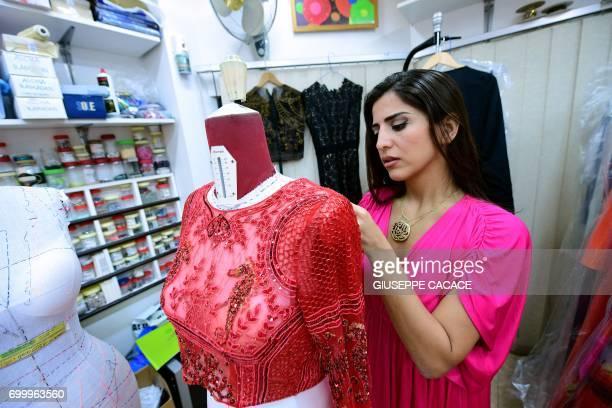Dubai based fashion designer Aiisha Ramadan is seen on June 10 2017 in her studio in Dubai United Arab Emirates From Dolce Gabbana to Michael Kors...