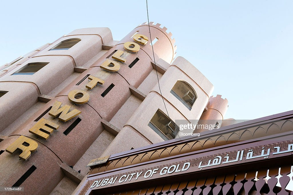 A 'Dubai City of Gold' sign sits on display at the entrance to the Dubai Gold Souk in the Deira district of Dubai, United Arab Emirates, on Tuesday, July 2, 2013. Gold swung between gains and losses in London as investors weighed prospects for increased physical demand against a slowing stimulus in the U.S. Photographer: Duncan Chard/Bloomberg via Getty Images