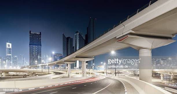 Dubai cityscape with bridges at night