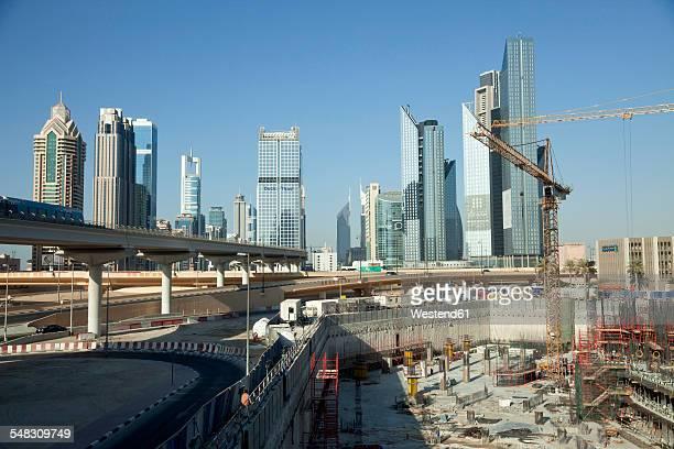 UAE, Dubai, construction site in front of skyscrapers