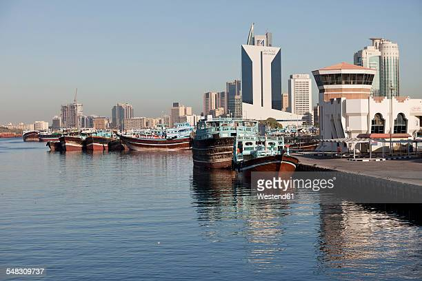 UAE, Dubai, Dhow harbor and skyscrapers at Dubai Creek