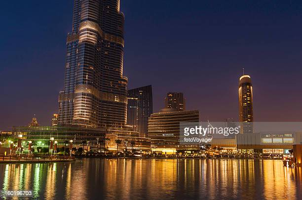 Dubai downtown lights shining in blue dusk UAE