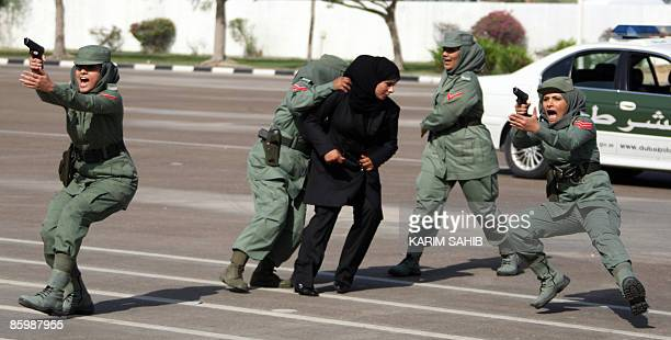 Dubai elite policewomen squad for VIPs show their skills during a graduation ceremony in the Gulf emirate on April 15 2009 In the male dominated UAE...