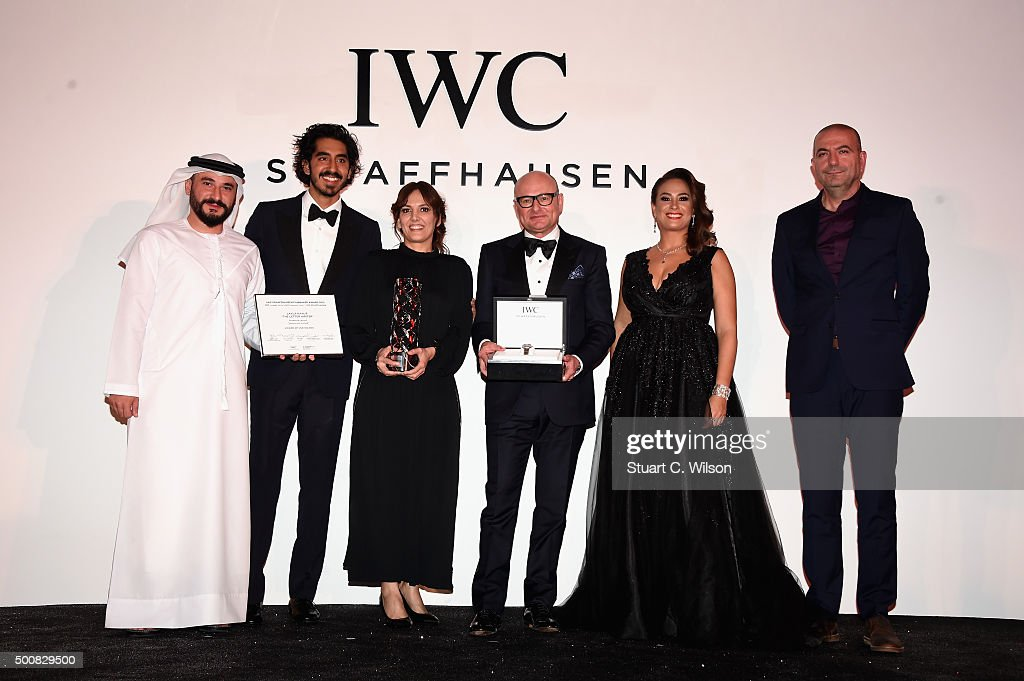 Dubai Film Market Manager Samer Al Marzooqi, IWC Brand Ambassador <a gi-track='captionPersonalityLinkClicked' href=/galleries/search?phrase=Dev+Patel&family=editorial&specificpeople=5123545 ng-click='$event.stopPropagation()'>Dev Patel</a>, IWC filmmaker award winner Layla Kaylif, CEO of IWC Schaffhausen <a gi-track='captionPersonalityLinkClicked' href=/galleries/search?phrase=Georges+Kern&family=editorial&specificpeople=623163 ng-click='$event.stopPropagation()'>Georges Kern</a>, actress Hend Sabry and Director Hany Abu Assad stand on stage during the IWC Filmmaker Award Night 2015 at The One & Only Royal Mirage on December 10, 2015 in Dubai, United Arab Emirates.