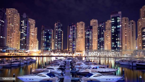 Dubai marina and cityscape at night