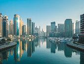 Wide angle establishing shot of the Dubai marina on a beautiful sunny morning.