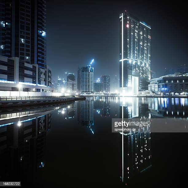Dubai marina with reflections and dark mood