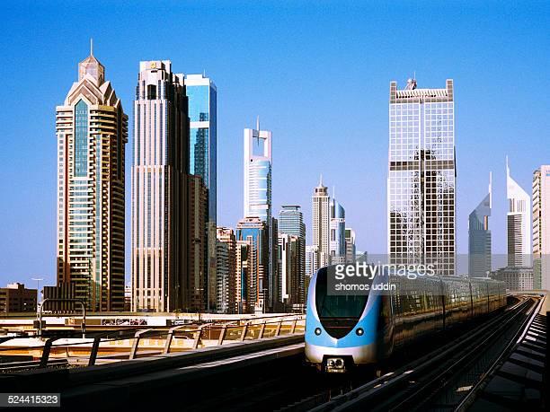 Dubai Metro with city skyline behind