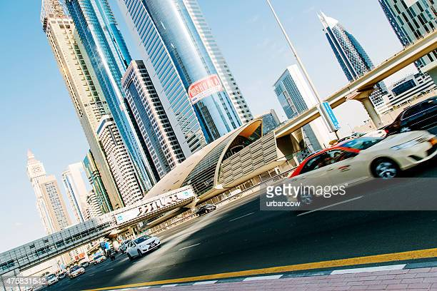 Dubai multiple lane highway, cityscape, contemporary architecture, vehicles in motion