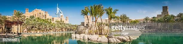Dubai palm trees lagoon hotels and restaurants Burj panorama UAE