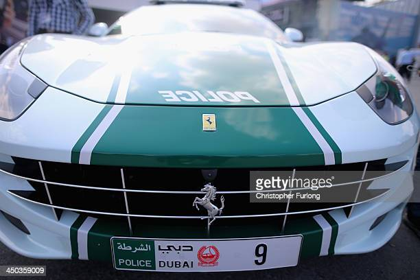 Dubai police Ferrari super car stands on display during the Dubai Airshow on November 18 2013 in Dubai United Arab Emirates The Dubai Air Show is the...