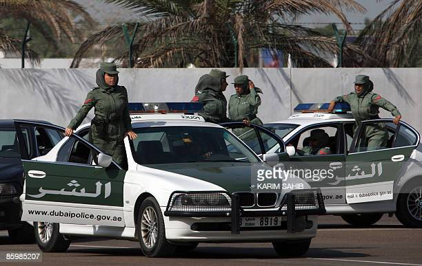 Dubai policewomen with an elite squad for VIPs show their skills during a graduation ceremony in the Gulf emirate on April 15 2009 In the male...