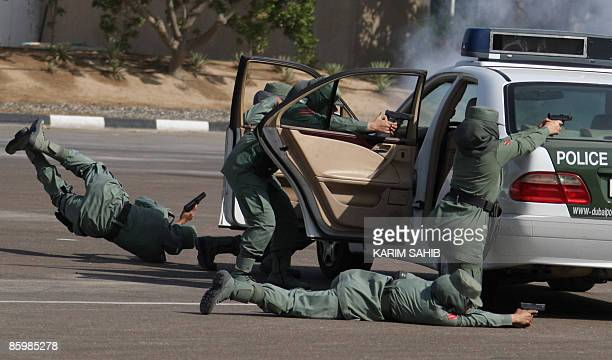 Image result for Dubai's elite policewomen squad for VIPs show their skills during a graduation ceremony