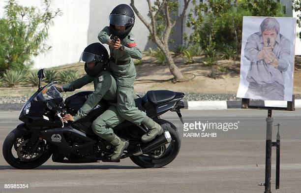 Dubai policewomen with an elite squad for VIPs show their skills on a motorbike during a graduation ceremony in the Gulf emirate on April 15 2009 In...