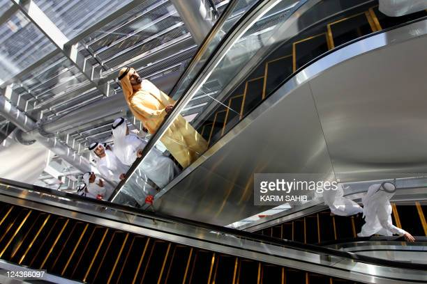 Dubai ruler Sheikh Mohammed bin Rashid alMaktoum arrives at a metro station to inaugurate the second metro rail network after a twoyear delay in the...