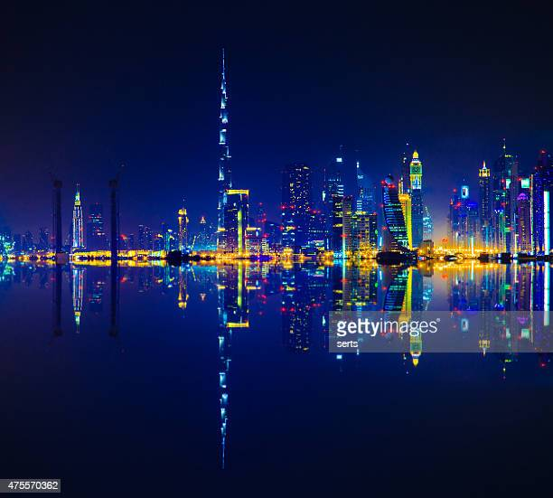 Dubai skyline reflection at night
