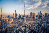 Dubai skyline with beautiful city close to it's busiest highway on traffic. Highway from Sarjah to Abudabi.