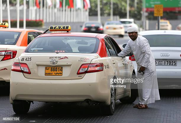 Dubai taxis wait for customers outside Dubai Mall in Dubai United Arab Emirates on Friday Nov 7 2014 The United Arab Emirates' central bank limited...